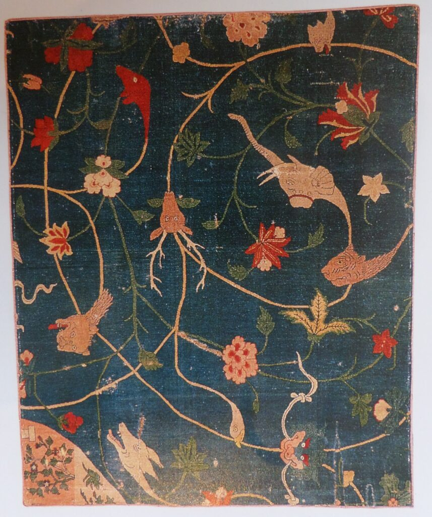 Blue rug with animal and floral handwoven design